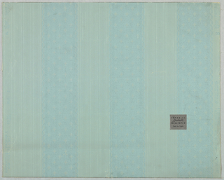 Pattern of vertical stripes, consisting of three medium blue lace-like stripes on pale gray-blue ground.
