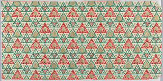 Green, red and gold pattern of repeating triangles, stars and holly.