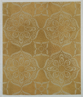 "Imitation leather. Geometric design of interlacing bands forming circular motifs. The effect is that of stencil work. The field is plain. The entire paper is embossed to represent grained leather and antiqued by hand. On reverse side is written:""8708EE."""