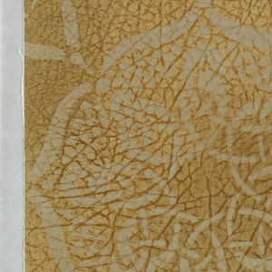 """Geometric design of interlacing bands forming circular motifs. The effect is that of stencil work. The field is plain. The entire paper is embossed to represent grained leather and antiqued by hand. On reverse side is written:""""8708EE."""""""