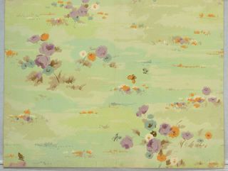 A simple floral design printed on a multicolor background. Petite flowers including roses are scattered across a patchwork-like ground.