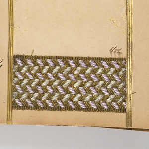 Hard covered, accordion-folded portfolio of about 175 trimming samples, many priced in French.