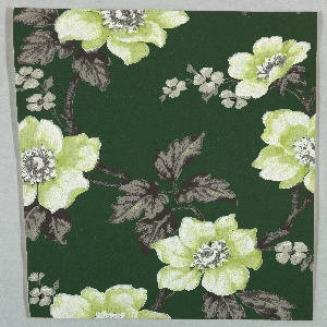 Floral wallpaper design with large pale green flowers or floral sprigs with brownish foliage. Printed on deep green ground.