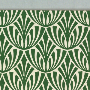 On white ground, stylized foliage pattern in green; these forms fitted into an over-all fish-scale design.