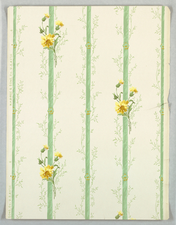 On white ground, green stripes with rosettes at intervals. Green vines, yellow flowers along stripes.
