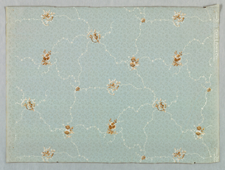 Small-scale floral in brown, peach and white, over mica fill of tiny flowers, on pastel blue ground.