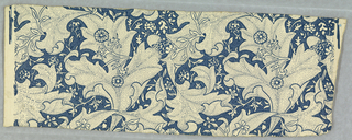 Design is composed of stylized leaves and flowers. Entire design and field is pin-pointed, blue on white and pale blue on dark blue. Printed in white on blue field.