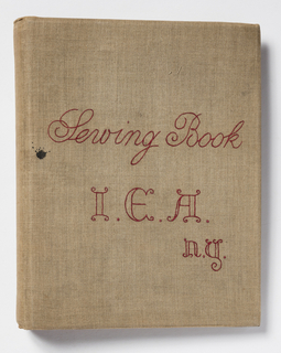 Small, bound sewing instruction book with hand-embroidered cover in red thread on natural linen. Inside the book, each left leaf contains a hand-written description of the sewing technique and its use. On the right, a small sample of the technique as executed by the student is attached to the page with small brass fasteners.