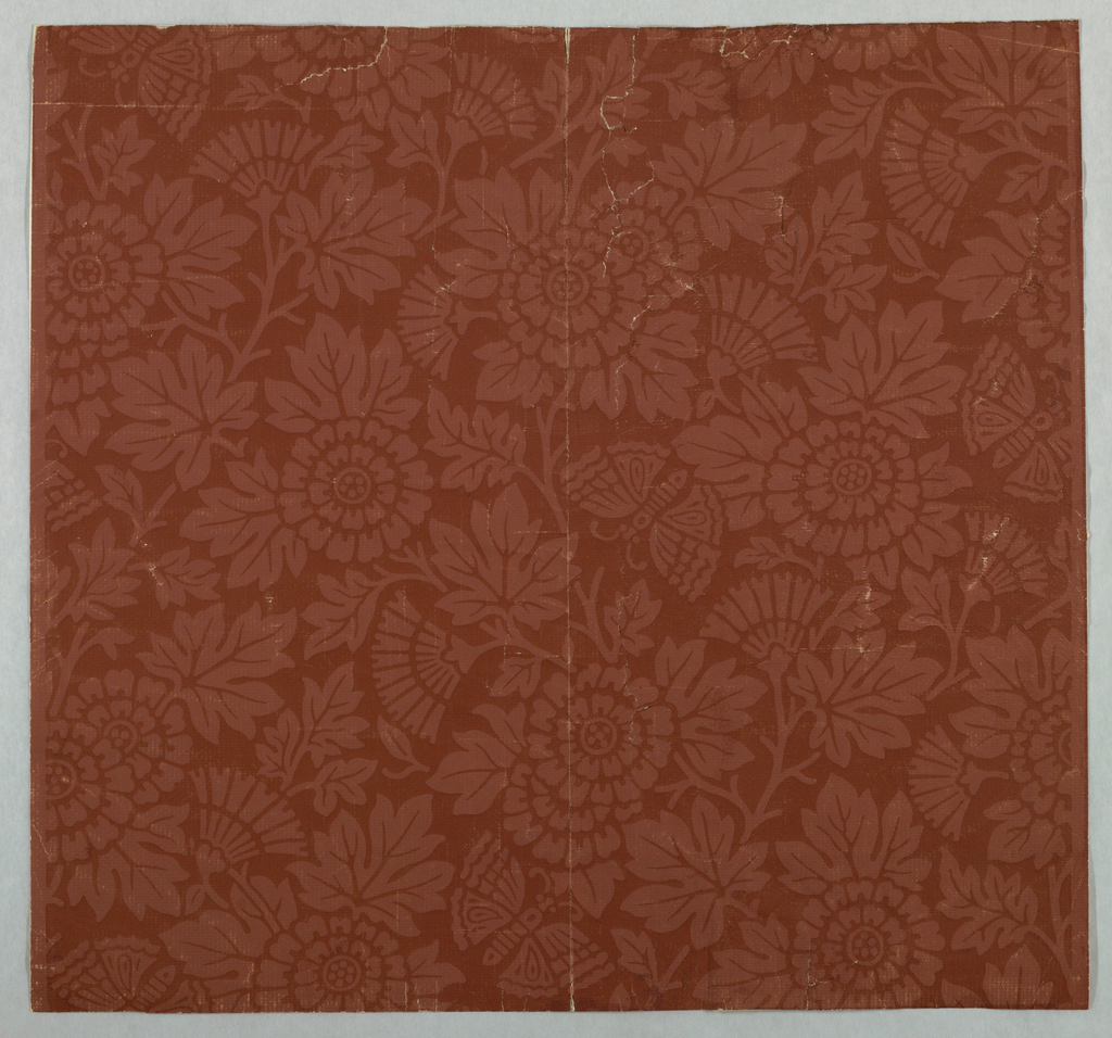 Horizontal rectangle giving a complete width. Stylized flowers and butterflies on paper stamped to imitate plain cloth. Stamped and printed in dark red-brown on lighter red-brown ground. Aesthetic-style design.