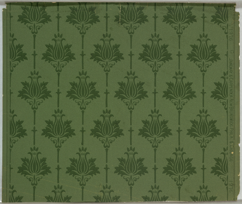 Deep green stylized floral stripe printed over background of pin dots and minute swirls. Printed on lighter green ground.