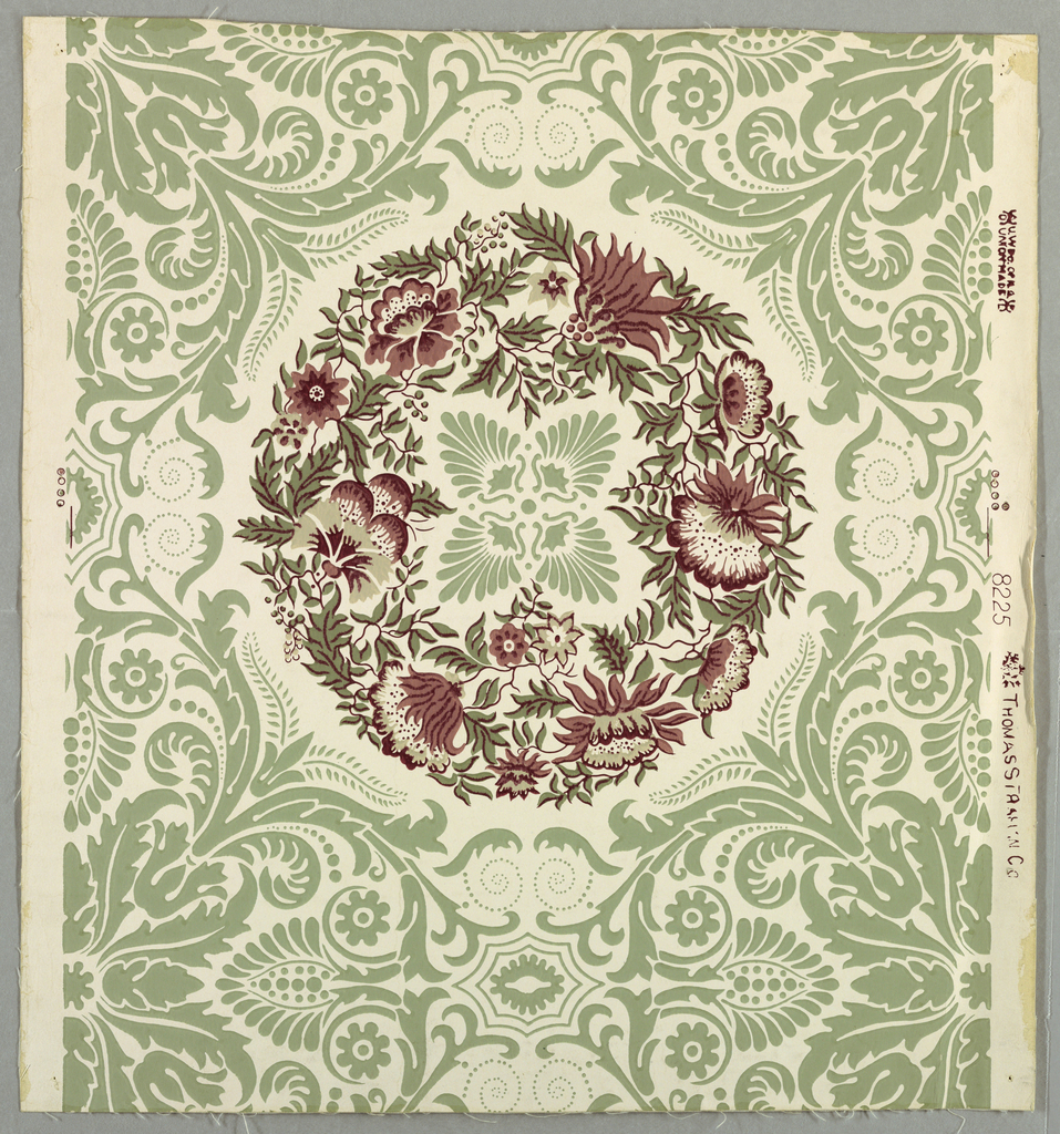 A framework of green leafy scrolls surrounds a major motif of a wreath of pink and white flowers with green leaves. This in turn encloses a center of four radiating palmettes. Straight across match.