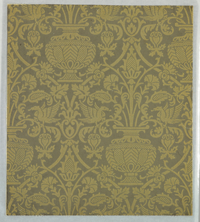 Simulates a two-toned Genoese velvet in a Renaissance design. Urns with carnations with affronted eagles on either side. This motif is enclosed in an interlacing scroll with carnation sprays at points of intersection. Both design and field done entirely in wool flock.