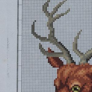 A stag's head, facing half-left.