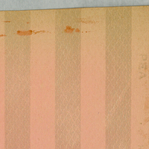 """Divided in one inch vertical stripes alternating, one dull pink, the other pink satin finish. Entire background of paper is embossed in a small diamond motif. Center of each diamond embossed in fine horizontal lines. Printed in pink on embossed paper. Printed in selvedge: """"PEA, 1028, Hobbs, Benton & Heath""""."""