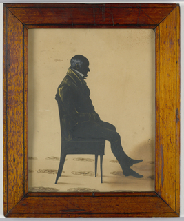 Full length silhouette of a man in chair, facing right. Wood frame.