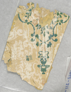 Floral medallion printed in greens with white floral scrolls and striped shading.