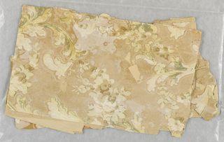 An acanthus scrolling design with mica highlights.