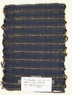 Sample of plain weave upholstery fabric with navy cotton warp and weft, with navy leather strip and jute incorporated in weft.