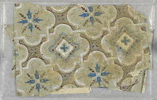 Quatrefoil pattern printed in blue and white on a beige ground.