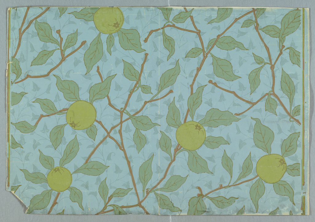 On light blue ground, sparse background fill of small ivy-like vines and leaves in gray-blue. Over this, pattern of brown branches with leaves and green apples.