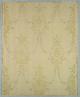 "A chaste design, Louis XVI in feeling, of oval small medallions of two-toned old ivory rayon flock. A stylized eight-petalled flower forms the center of medallion. These ovals form a diagonal pattern looped together by festooned narrow ribbons and vines. Ribbons are ties in loose knots. Printed on embossed field simulating a striped moire silk combined with a twill stripe, both narrow. printed in margin: Birge made in U.S.A. 1253 U.W.P.Co. of N.A. Union Made""."
