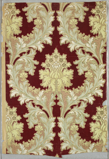 On deep red background, alternating floral motif wreathed in pluming foliage in metallic gold and shades of pale green. Printed on mica ground.