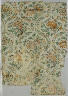 Floral pattern, with style in Indian chintz design, printed in orange, green and brown on gray background. This piece has been cut and pasted together.