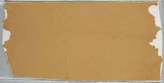 Tan colored ingrain paper with no printed design, contains many grayish fibers.