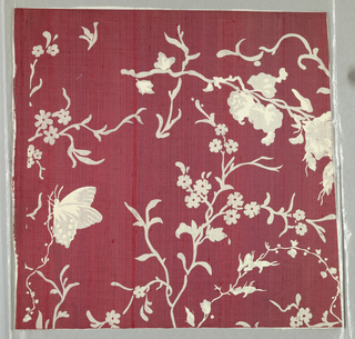 Incomplete width showing white flowering branches and butterfly on red silk ground. The thin silk, in turn, is pasted on a pink paper ground.