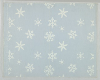 Design of six different forms representing snow flakes scattered over ground. Printed in white on pale blue ground.
