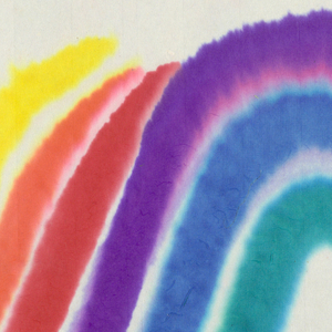 Wavy rainbow pattern in rainbow colors on white paper.