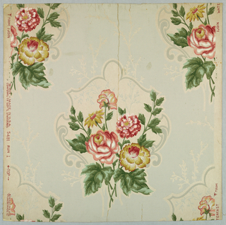 Design of flowering sprays in natural colors, on white irregularly shaped medallions on gray ground.