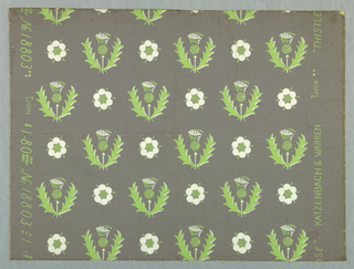 Repeat design of thistle and leaves shown from the side and rose shown from above, printed in green and white on gray ground.