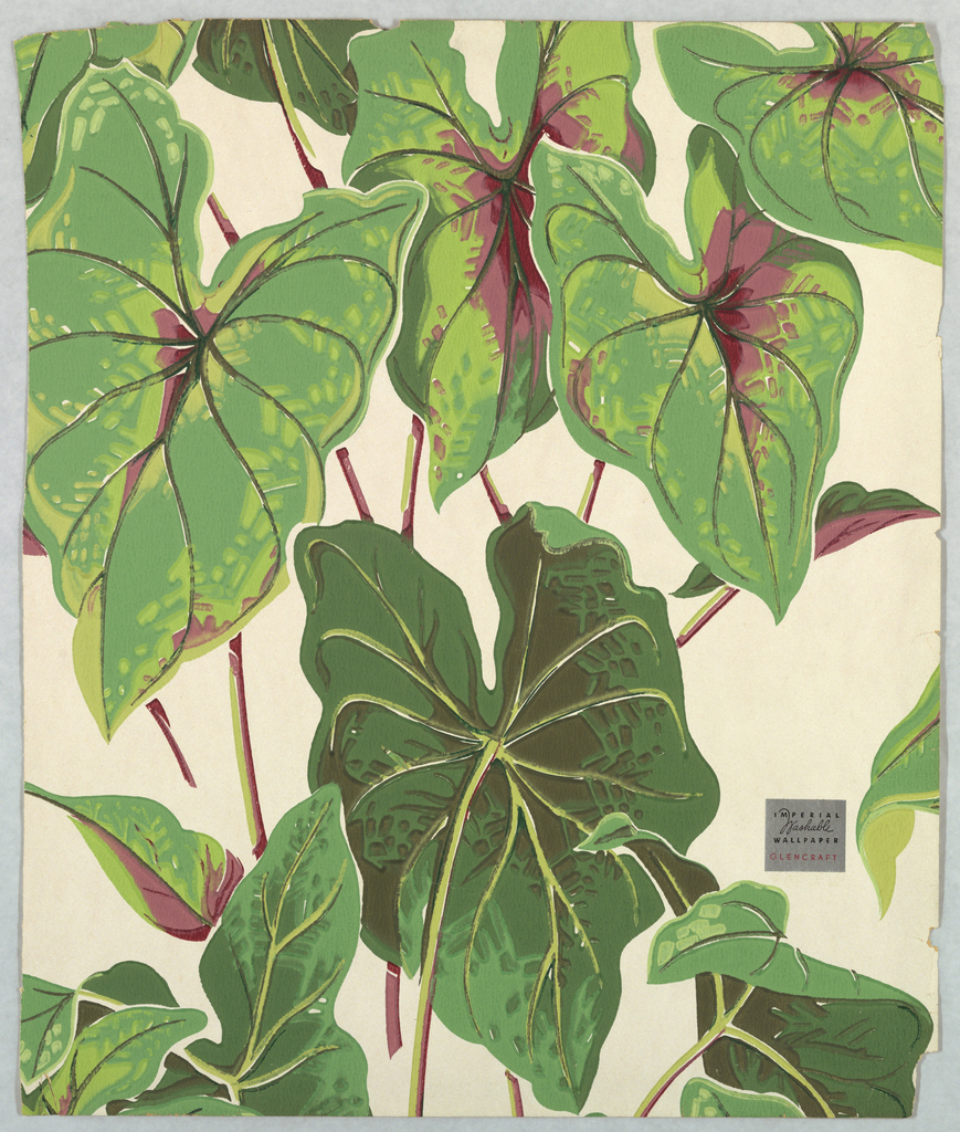 Design of philodendrens, large green leaves printed on off-white ground.