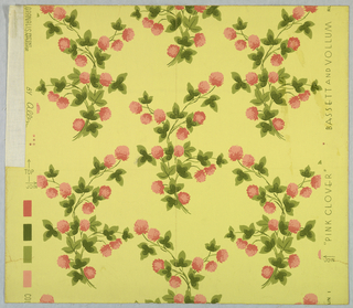 Design of flowering clover sprays in two shades of pink and two shades of green on yellow ground.