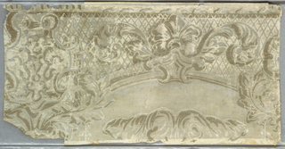 A repeat of a border in the Victorian rococo style with floral scrolls and cartouches against a diapered ground. The ground appears to be an off-white; all other colors have flaked off.