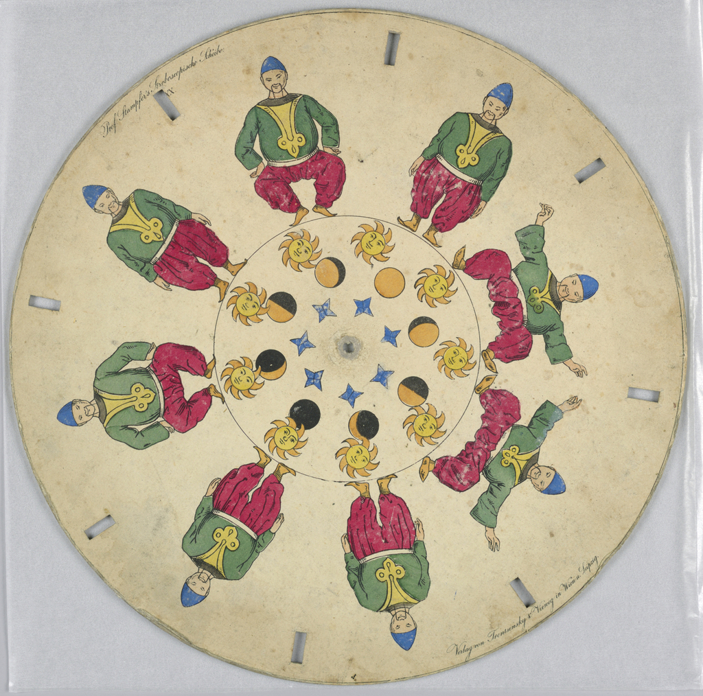 Paper disc with a hole in the center, 8 rectangular perforations evenly spaced along perimeter for viewing. In the outermost ring, several still images show a dancing man in oriental costume in various stages of a low squat. In the innermost ring, a sun with a face  orbits around a planet, showing the stages of day and night. Closest to the central perforation is a ring of blue stars at various angles.