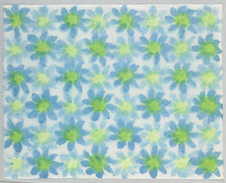 Blue flowers with green centers.