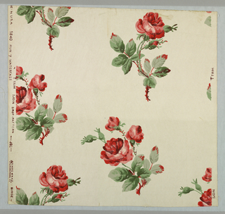 Pattern of red roses with green leaves, printed on white ground.