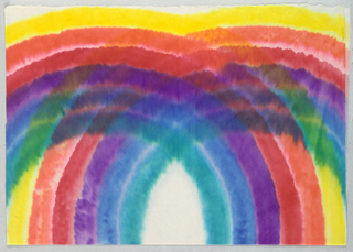Overlapping circles in rainbow colors on white paper.