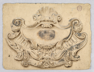 An escutcheon crowned by a shell.