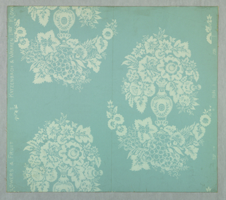 Design in drop repeat of vase containing flowers above swag of flowers and fruit. Printed in white on pale blue ground.