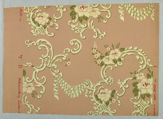 Design of scrolls with drapery, flowers, and leaves. Printed in red, white and green on pink ground.