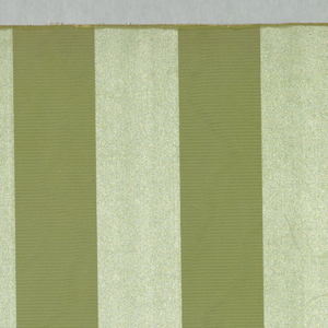Alternating vertical bands, one band being lighter in color than the other and embossed to simulate satin. The total number of bands to a width is twelve. Printed in two shades of light green.