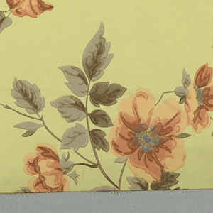 Large central floral image, red flowers with green leaves, with vining tendrils, printed on light yellow ground. Drop match.