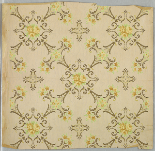 On tan moire ground, overlapping floral diamond motif of brown scrolling trim framing yellow flowers and green leaves.