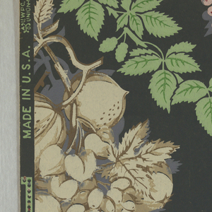 Slate ground with leafy green branches forming a diagonal network. The latter enframes a repeating motif, a large cluster of fruit: pomegranates,melons, grapes, the color of which is pink in one vertical series, the adjoining vertical series being off-white.