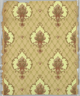 Foliate medallion printed on tan background with green diaper pattern.