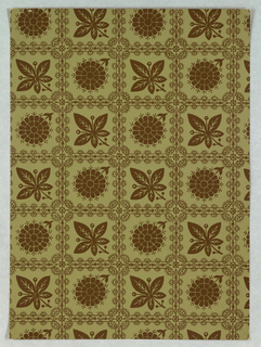Against a light gray olive-green ground are printed bands of lacy square framework enclosing simplified leaf and blossom motifs. Framework and enclosed motifs are printed in a single value of dark green gray-brown. Straight repeat.