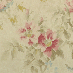 Large blossoms in pink and mustard and smaller blue flowers and mustard colored flowers. A bird in flight and another one perched on a branch. Birds are pink and blue with yellow beaks. On white ground.